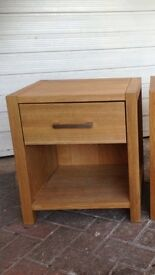 Two oak bedside tables with drawer