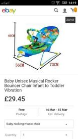 Musical and vibrating baby bouncer