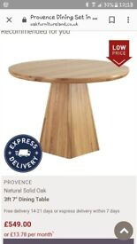 Round solid wooden table. Oak furniture land. Conditon is as good as new!