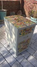 Small chest of drawers upcycled in stone coloured paint and Marvel comic decoupage