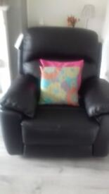 Black leather reclining armchair (as new)