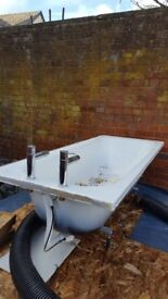 Free bath, taps and waste. Had to be taken out of existing bathroom for shower tray.