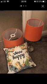 Orange lamp, light shade and small pillow