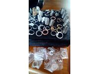Fifty five assortment of fashion rings all new