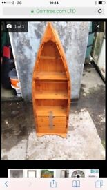 Boat shaped shelving unit