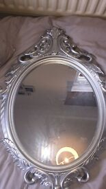 Beautiful ornate silver mirror
