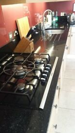 Black granite kitchen counter top; full set in several pieces