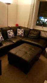 Black leather corner suite with pouffe
