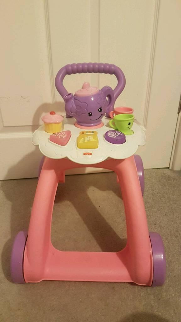 e6848b7f8e32 Baby girl push along tea trolley walker Fisher price