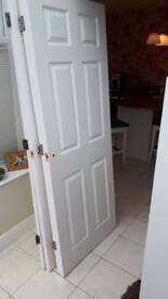 white gloss wood door with hinge