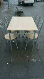 Wooden dining table with chairs