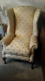 gold patterned wing chair
