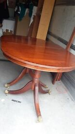 Mahogany table Extend to seat 8 velour chairs- 2 with arms Good condition Protective cover +++
