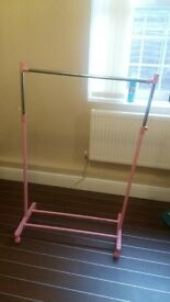 single pink clothes rail