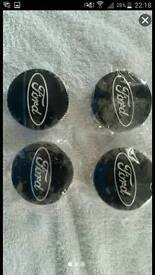 Genuine set of ford centre caps in black