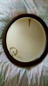 Antique wooden oval mirror
