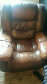 Brown leather recliner/rocking chair