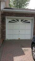 2 garage doors with there motor