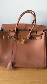 Large tan leather handbag