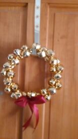 Jingle bells door decoration with red bow
