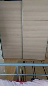 Wardrobe with sliding doors a chest of drawers and two bedside cabinets