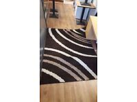 Chocolate-coloured Brown and White-striped Rug in Great Condition