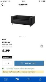 Ikea klippan sofa with black fabric cover