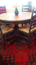 Beautiful round pedestal table and chairs