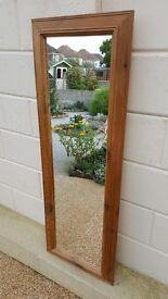 Full length glass mirror in a ridged pine frame, very good condition!