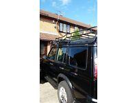 Land rover safari roof rack with 4 hella spot lights