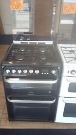 HOTPOINT 60CM DUAL FUEL COOKER WITH LID IN BLACK