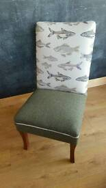 Traditionally reupholstered armless chair with sprung seat