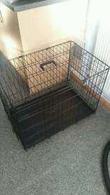 Medium dog cage with bottom tray, never used, still in box