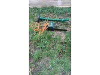 chainsaw and grass strimmer