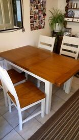 Solid oak table. Brilliant condition. Table extends.