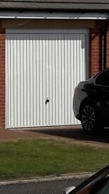 Garage door 2285mm wd x 2180 hg with internal support bar spans width, fixed to wall at high level