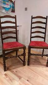 2 matching ladder back solid wood chairs