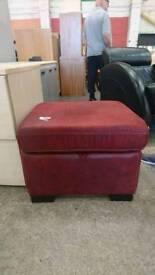 Red storage pouffe