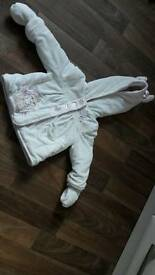 White baby girls warm coat 9-12mths with Thumper design.