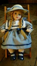 Porcelain Doll in wooden deckchair