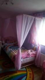 Girls pink 4 poster bed very good condition