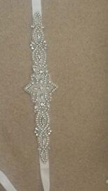 An elegant wedding dress sash