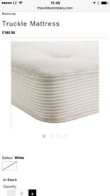 Brand new. The White Company Middleton single truckle mattress