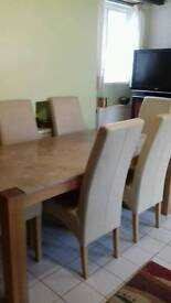 Marble table and plinth 6 leather chairs