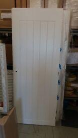 Set of white internal doors unused.