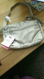 Kippling small metallic bag new with tags