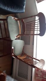 A pair of Dining table chairs with unusual carving. £10 each.