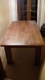 Solid chunky pine dining table.