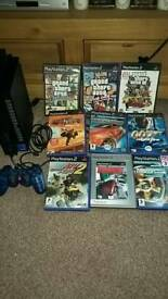 PS2 console controller and 9 games