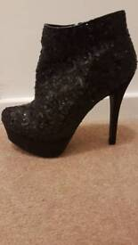 Black sequence boots size 6